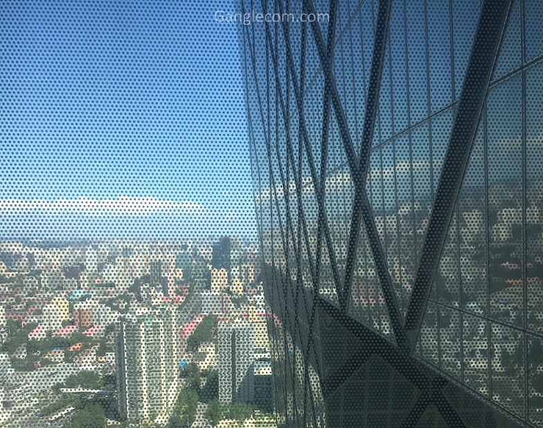 Window view from CCTV Headquarters with side of tower in frame